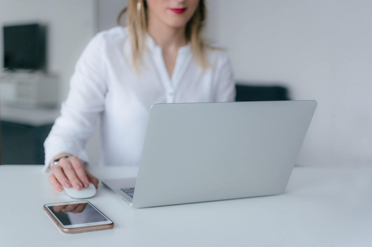 woman-using-silver-laptop-2265488-1